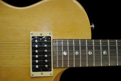 Guitarra eléctrica en fondo negro Imagenes de archivo