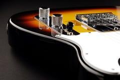 Guitarra eléctrica en negro Imagen de archivo libre de regalías