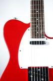Guitarra eléctrica roja en blanco Imágenes de archivo libres de regalías