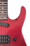 Guitarra eléctrica roja en el fondo blanco Imagen de archivo libre de regalías