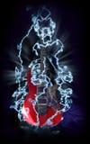 Guitarra eléctrica roja en relámpagos Imagen de archivo