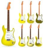 Guitarra elétricas amarelas Fotografia de Stock Royalty Free