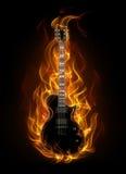 Guitarra en fuego Foto de archivo libre de regalías