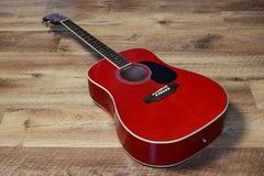 Guitarra en un piso Fotos de archivo
