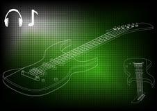 Guitarra en un verde Fotos de archivo libres de regalías