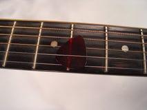 Guitarra Frett e picareta Imagens de Stock