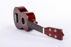 Guitarra hawaiana moderna con cuatro secuencias fotos de archivo