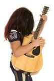 Guitarra larga del juego del pelo del futbolista Imagen de archivo