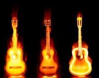 Guitarra llameante en el fuego Fotografía de archivo libre de regalías
