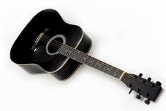 Guitarra negra Foto de archivo libre de regalías