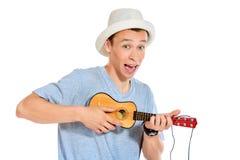 Guitarra pequena Fotos de Stock Royalty Free