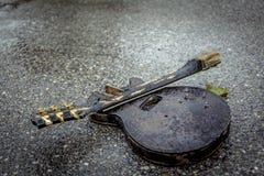 Guitarra quebrada Imagens de Stock