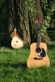 Guitarra vieja y nueva Imagen de archivo libre de regalías