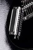 Guitarra y armónica Fotos de archivo libres de regalías
