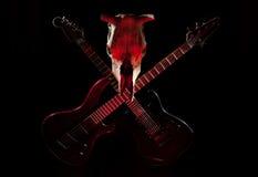 Guitarra y cráneo Foto de archivo