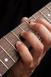 Guitarra y mano Imagen de archivo