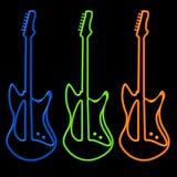Guitarras en neón Imagenes de archivo