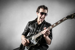 Guitarrista agradável Imagem de Stock