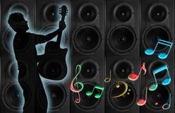 Guitarrista, altavoces y notas musicales Imagen de archivo