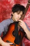 Guitarrista con la guitarra Imagenes de archivo