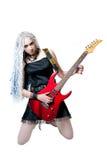 Guitarrista de la muchacha con la guitarra roja Imágenes de archivo libres de regalías