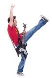 Guitarrista de retroceso con el pie y de griterío Fotografía de archivo