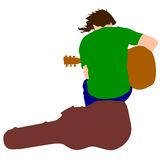 Guitarrista del músico de la silueta que se sienta en Imagen de archivo