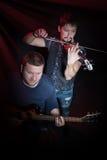 Guitarrista e violinista da faixa Foto de Stock