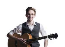 Guitarrista novo Fotografia de Stock Royalty Free
