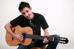 Guitarrista novo - Jon Imagens de Stock Royalty Free