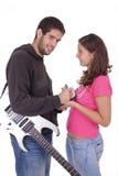 Guitarrista y muchacha del ventilador Foto de archivo