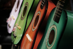 Guitars. Row of colored acoustic guitars Royalty Free Stock Photography