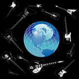 Guitars around globe Royalty Free Stock Photos