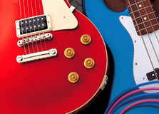 Guitars. Colorful electric guitars and cables laying on the floor Royalty Free Stock Photography