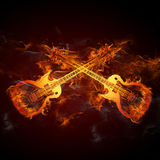 Guitars fire. Two Guitars in fire - hot rock n roll illustration Royalty Free Stock Photo