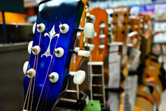 Guitars hanging on wall of music studio. Guitars in the music store Royalty Free Stock Photo