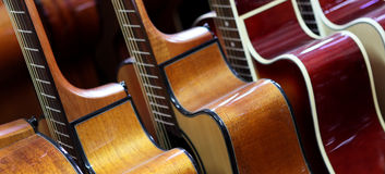 Guitars. Lined up in a row stock image