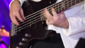 Guitars in live action at a concert. Man is playing the guitar on the concert stock footage
