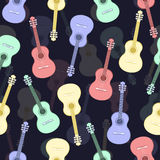 Guitars multicolored seamless pattern, musical background. Colorful drawn guitar on a dark blue . Vector illustration Royalty Free Stock Image