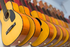 Guitars in Music school on the wall. Yellow guitars hanging on the wall in Music school Royalty Free Stock Photography
