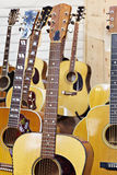 Guitars at music store Stock Photography