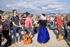 Free Guitars On The Beach - Lyme Regis Stock Images - 87999254