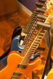 Guitars. In a rack in studio Stock Photo