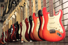 Guitars for Sale. Row of electric guitars for sale in music shop Royalty Free Stock Photos