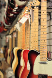 Guitars for Sale Hanging. Row of electric guitars for sale in music shop Royalty Free Stock Photos