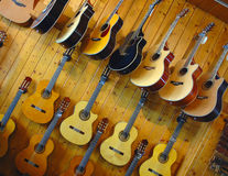 Guitars in shop of musical instruments Royalty Free Stock Photography