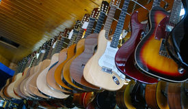 Guitars on a show-window Stock Images