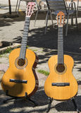 Guitars in the sun. Instruments prepared to sound at the party Royalty Free Stock Image