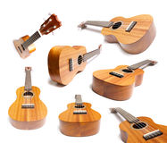 Guitars or Ukelele collection. Isolated on white royalty free stock images