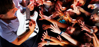 Guitarsolo at a rock concert. Concert picture of a guitarist performing for his adoring fans Royalty Free Stock Images
